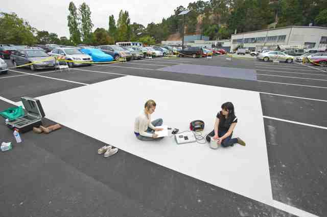 Sharon Chen and Ana Paula Werle of EETD Heat Island Group taking measurements on the cool pavement  solar-reflective coatings in the Bevatron parking lot.